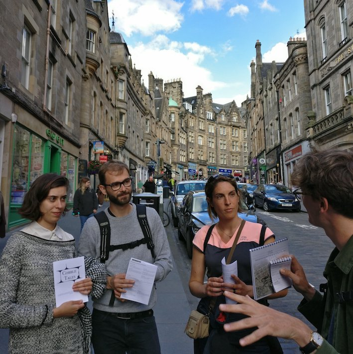 Group on Cockburn street on walking tour in Edinburgh