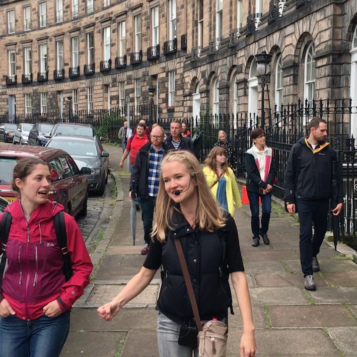 The group walking on the street on Edinburgh New Town Architecture Tour