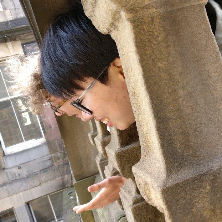 People sticking heads between balusters on walking tour in Edinburgh