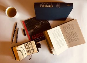 Books, tea and sketchbook by our Edinburgh walking tour guide
